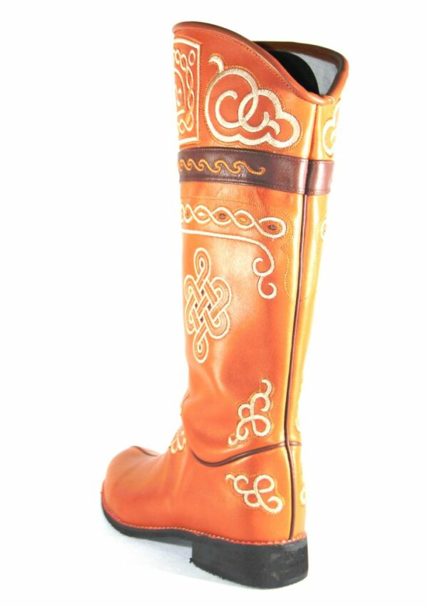 Ethnic boots made by white stitches
