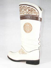 White boots with golden stitching