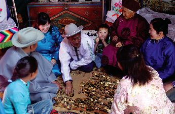 adults playing shagai catching