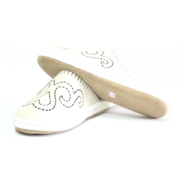 Left Side of White Slippers