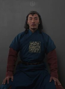 Mongolian Men's Wearing Deel and Sitting