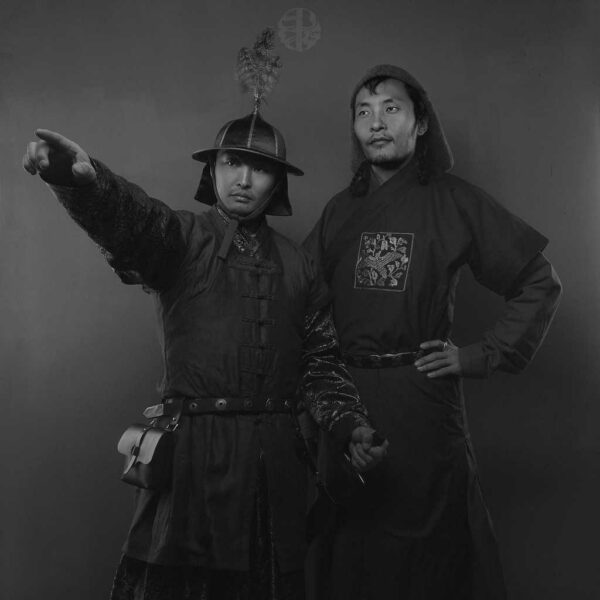 Mongolian Men's Wearing Deel and Pointing